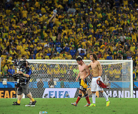 FORTALEZA - BRASIL -04-07-2014. James Rodriguez (#10) jugador de Colombia (COL) abandona el campo de juego con David Luiz (#4) jugador Brasil (BRA) al final del partido de los cuartos de final por la Copa Mundial de la FIFA Brasil 2014 jugado en el estadio Castelao de Fortaleza./ James Rodriguez (#10) player of Colombia (COL) leaves the field with David Luiz (#4) player of Brazil (BRA) after the match of the Quarter Finals for the 2014 FIFA World Cup Brazil played at Castelao stadium in Fortaleza: Photo: VizzorImage / Alfredo Gutiérrez / Contribuidor