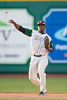 Fort Wayne TinCaps shortstop Ruddy Giron (12) makes a throw to first base against the West Michigan Whitecaps on May 23, 2016 at Parkview Field in Fort Wayne, Indiana. The TinCaps defeated the Whitecaps 3-0. (Andrew Woolley/Four Seam Images)
