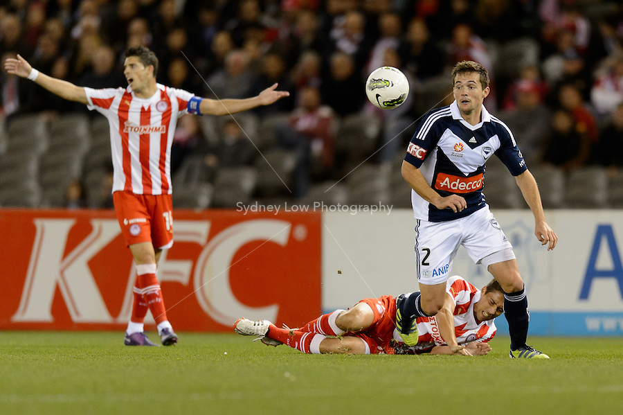 MELBOURNE, AUSTRALIA - MAY 19: Kevin Mirallas of Olympiakos reacts after  Matthew Foschini of the Victory commits a foul during a match between Melbourne Victory and Olympiakos FC at Etihad Stadium on 19 May 2012 in Melbourne, Australia. (Photo Sydney Low / AsteriskImages.com)