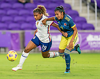 ORLANDO, FL - JANUARY 22: Catarina Macario #29 of the USWNT fights for the ball with Daniela Arias #3 of Colombia during a game between Colombia and USWNT at Exploria stadium on January 22, 2021 in Orlando, Florida.