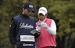 JEJU, SOUTH KOREA - APRIL 22:  Pablo Larrazabal (R) and his brother and caddie Alejandro Larrazabal of Spain talk on the 14th tee during the Round One of the Ballantine's Championship at Pinx Golf Club on April 22, 2010 in Jeju island, South Korea.  Photo by Victor Fraile / The Power of Sport Images