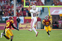 LOS ANGELES, CA-OCTOBER 29,2011- Stanford defeated USC 56-48. Coby Feener (82) leaps high for a pass reception during play against USC at the L.A. Coliseum in Los Angeles, CA.