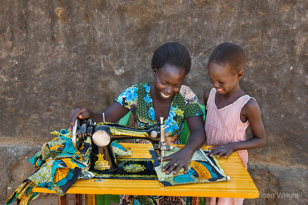 AWright_SUD_004003.jpg<br /> South Sudan<br /> In Hai Cost, Juba, Abau Flora (26) received sewing and tailoring lessons and a sewing machine from BRAC. Her business now earns about $80 per month, which she uses to support her husband and three children.