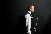 CHINA. Beijing. Scottish snooker player Stephen Hendry MBE  backstage just before going to play at the China Snooker Open. Stephen Hendry is arguably the greatest snooker player of all time, having won 7 World Championships and having career earnings of over 8 million British Pounds. Snooker is a cue sport played on a large table measuring 3.6 metres x 1.8 metres. Originating in India in the late 19th Century where it was invented by British Army officers, the game has been a mainstay in British sport over the past few decades. Recently however, popularity of the sport has declined as the sport struggles to compete with other popular sports. The sport is however flourishing in countries such as China, where it is now the second most popular sport, behind Basketball. In a country where the  players are treated like movie-stars, China may be the great hope for the sports recovery. 2009