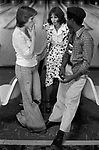 Group of teenagers hanging out in bowling alley Stevenage Hertfordshire 1970s England  <br /> Teen girl smoking.