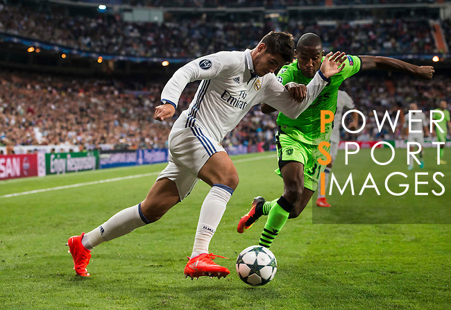 Alvaro Morata of Real Madrid battles for the ball during their 2016-17 UEFA Champions League match between Real Madrid vs Sporting Portugal at the Santiago Bernabeu Stadium on 14 September 2016 in Madrid, Spain. Photo by Diego Gonzalez Souto / Power Sport Images