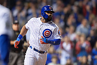 Chicago Cubs Jason Heyward (22) runs to first base after hitting a single in the second inning during Game 4 of the Major League Baseball World Series against the Cleveland Indians on October 29, 2016 at Wrigley Field in Chicago, Illinois.  (Mike Janes/Four Seam Images)