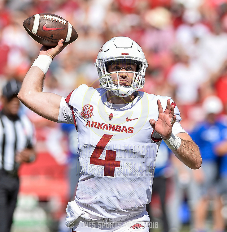 Arkansas quarterback TY STOREY looks to pass during Saturday's game against Eastern Illinois at Donald W. Reynolds Razorback Stadium in Fayetteville.