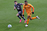ST PAUL, MN - OCTOBER 18: Ethan Finlay #13 of Minnesota United FC and Mauro Manotas #9 of Houston Dynamo go after the ball during a game between Houston Dynamo and Minnesota United FC at Allianz Field on October 18, 2020 in St Paul, Minnesota.