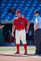 Clearwater Threshers manager Shawn Williams (11) meets with the umpires before the first game of a doubleheader against the Palm Beach Cardinals on April 13, 2017 at Spectrum Field in Clearwater, Florida.  Clearwater defeated Palm Beach 1-0.  (Mike Janes/Four Seam Images)