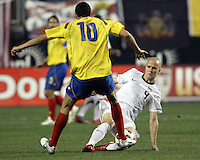 Michael Bradley #4 of the USA MNT tackles Giovani Moreno #10 of Colombia during an international friendly match at PPL Park, on October 12 2010 in Chester, PA. The game ended in a 0-0 tie.