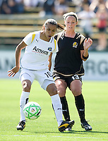 24 May 2009: Marta of the Los Angeles Sol dribbles the ball away from Kristen Graczyk of the FC Gold Pride during the game at Buck Shaw Stadium in Santa Clara, California.  Los Angeles Sol defeated FC Gold Pride, 2-0.