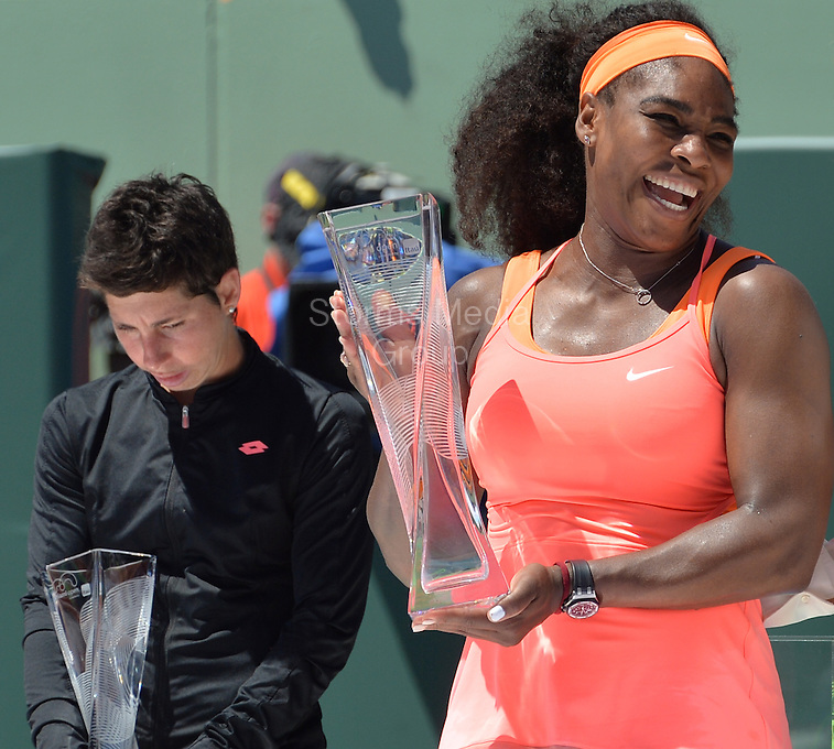KEY BISCAYNE, FL - APRIL 04: Serena Williams poses with the Butch Buchholz Trophy as she stands with Martina Navratilova after defeating Carla Suarez Navarro of Spain after the Women's Finals match on day 13 of the Miami Open at Crandon Park Tennis Center on April 4, 2015 in Key Biscayne, Florida<br /> <br /> <br /> People:  Carla Suarez, Serena Williams<br /> <br /> Transmission Ref:  FLXX<br /> <br /> Must call if interested<br /> Michael Storms<br /> Storms Media Group Inc.<br /> 305-632-3400 - Cell<br /> 305-513-5783 - Fax<br /> MikeStorm@aol.com