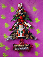 Christmas tree made up of festive christmas gifts and santas