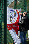 A visiting supporters putting up his team's flag on railings before Warrington Town played King's Lynn Town in the Northern Premier League premier division super play-off final tie at Cantilever Park, Warrington. The one-off match was between the winners of play-off matches in the Northern Premier League and the Southern League Premier Division Central to determine who would be promoted to the National League North. The visitors from Norfolk won 3-2 after extra-time, watched by a near-capacity crowd of 2,200.