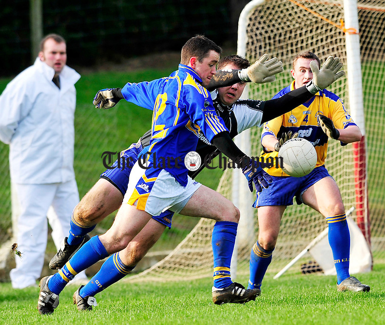 Clare v Tipperary Division 4 Round 2 football league at Ardfinnan co Tipperary.Pic Arthur Ellis...Clares Joe Hayes tries to block a shot from Tipperarys Damien O'Brien