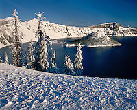 Winter morning light on Wizard Island viewed from the rim of Crater Lake; Crater Lake National Park, WY