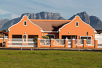 South Africa, Cape Town, Athlone Suburb.  Cape Dutch Style House.  Table Mountain in Background.