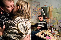 Valery Zhukov, a married miner and union representative, dances with his lover Lena while his friend Alexander sits at a table in the background.<br /> Vorkuta is a coal mining and former Gulag town established beyond the Arctic Circle, where temperatures in winter drop to -50C. Russia's far north is slowly declining. Every year thousands of people from its towns and cities flee south. The system of subsidies that propped up Siberia and the Arctic in Soviet times has crumbled. Now there is no advantage to living in the far north, salaries are no higher than in central Russia and prices for goods are higher. /Felix Features