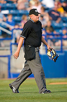Home plate umpire Tyler Wilson walks to the mound to break up a meeting during a Carolina League game between the Kinston Indians and the Salem Red Sox at Lewis-Gale Field May 1, 2010, in Winston-Salem, North Carolina.  Photo by Brian Westerholt / Four Seam Images