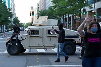 A demonstrator sits on a military vehicle during a protest in Washington, D.C., U.S., on Monday, June 1, 2020, following the death of an unarmed black man at the hands of Minnesota police on May 25, 2020.  More than 200 active duty military police were deployed to Washington D.C. following three days of protests.  Credit: Stefani Reynolds / CNP/AdMedia