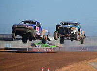Apr 16, 2011; Surprise, AZ USA; LOORRS driver Robby Woods (99) races alongside Bryce Menzies (7) during round 3 at Speedworld Off Road Park. Mandatory Credit: Mark J. Rebilas-