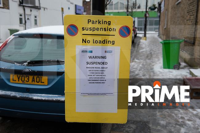 Parking restrictions on Hadlow Road during COVID-19 Vaccinations at Aspire Pharmacy, Hadlow Road, Sidcup, Kent, England on the 8 February 2021. Photo by Alan Stanford.