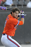 Right fielder Steven Duggar (9) of the Clemson Tigers warms on before a game against the Wofford College Terriers on Tuesday, May 5, 2015, at Russell C. King Field in Spartanburg, South Carolina. Wofford won, 17-9. (Tom Priddy/Four Seam Images)