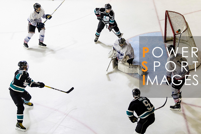 Drew Barton of Cathay Flyers (L) scores against Rodolphe Brunetti of Flying French Goalie (R) during the Mega Ice Hockey 5s match between Flying French and Cathay Flyers on May 03, 2018 in Hong Kong, Hong Kong. Photo by Marcio Rodrigo Machado / Power Sport Images
