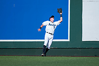 Everett AquaSox left fielder Charlie McConnell (19) prepares to catch a fly ball during a Northwest League game against the Tri-City Dust Devils at Everett Memorial Stadium on September 3, 2018 in Everett, Washington. The Everett AquaSox defeated the Tri-City Dust Devils by a score of 8-3. (Zachary Lucy/Four Seam Images)