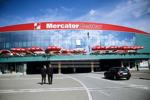 Sarajevo, Bosnia and Herzegovina. View of shopping centre (Mercator Centar) - modern building; sunshades with Coca - Cola advert.