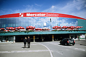 Sarajevo, Bosnia and Herzegovina. View of shopping centre (Mercator Centar) - modern building; sunshades with Coca - Cola advert.