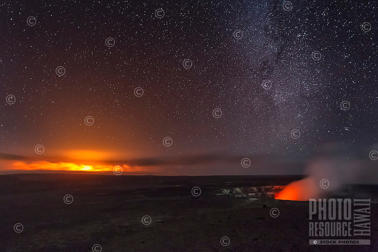 Stars of the Milky Way provide a distant, additional glow at a 2011 fissure eruption, Halema'uma'u Crater, Hawai'i Volcanoes National Park, Big Island.