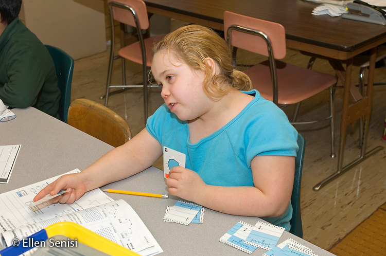 MR / Schenectady, NY.Yates Arts-in-Education Magnet School (urban public elementary school).Self-Contained Special Education Class - but students also mainstreamed several hours a day..Girl (10) doing math lesson using workbook..MR: Zur1.© Ellen B. Senisi