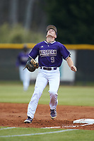 Western Carolina Catamounts first baseman Daylan Nanny (9) tracks a pop fly during the game against the St. John's Red Storm at Childress Field on March 12, 2021 in Cullowhee, North Carolina. (Brian Westerholt/Four Seam Images)