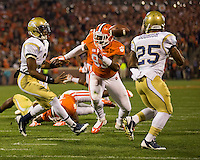 The eighth ranked Clemson Tigers defeat the Georgia Tech Yellow Jackets at Death Valley 55-31 in an ACC matchup.  Georgia Tech Yellow Jackets quarterback Vad Lee (2) pitches the ball to Georgia Tech Yellow Jackets running back Robert Godhigh (25), Clemson Tigers defensive end Corey Crawford (93)