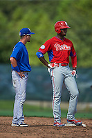 Philadelphia Phillies Domonic Brown (9) talks with JC Cardenas (7) during an instructional league game against the Toronto Blue Jays on October 3, 2015 at the Carpenter Complex in Clearwater, Florida.  (Mike Janes/Four Seam Images)