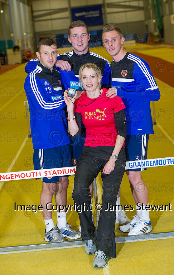 Scots Athlete Eilidh Child take Hearts' players Dale Carrick, Jack Hamilton and Kevin McHattie through their paces at Grangemouth Stadium.