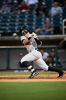 Birmingham Barons shortstop Danny Mendick (2) follows through on a swing during a game against the Pensacola Blue Wahoos on May 8, 2018 at Regions FIeld in Birmingham, Alabama.  Birmingham defeated Pensacola 5-2.  (Mike Janes/Four Seam Images)