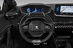 Car pictures of steering wheel view of a 2020 Peugeot e-208 GT 5 Door Hatchback Steering Wheel