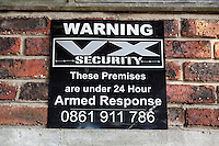 South Africa, Cape Town.  Sign Warning Intruders that Facility is under Armed Security Protection.