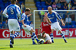 St Johnstone v Aberdeen....18.08.12   SPL.Scott Vernon is booked for this lunge on Paddy Cregg.Picture by Graeme Hart..Copyright Perthshire Picture Agency.Tel: 01738 623350  Mobile: 07990 594431