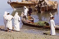 Kuwait September 1966.  Afternoon Scene on the Sief Waterfront. AN ADDITIONAL 100 HISTORIC IMAGES OF KUWAIT MADE BETWEEN 1966-1972 ARE AVAILABLE.  LET US KNOW WHAT YOU NEED.