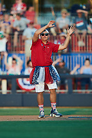 """Kannapolis Cannon Ballers Assistant General Manager Vince Marcucci dances as part of the """"Ballerinas"""" between innings of the game against the Charleston RiverDogs at Atrium Health Ballpark on July 4, 2021 in Kannapolis, North Carolina. (Brian Westerholt/Four Seam Images)"""