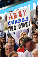 """A fan holds up a sign reading """"Abby chases no one"""". The women's national team of the United States defeated the Korea Republic 5-0 during an international friendly at Red Bull Arena in Harrison, NJ, on June 20, 2013."""
