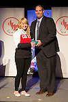 Calgary, AB - June 5 2014 - Alexandra Starker receives her Paralympic Ring from Rob Mason, of HBC, during the Celebration of Excellence Paralympic Ring Reception in Calgary. (Photo: Matthew Murnaghan/Canadian Paralympic Committee)