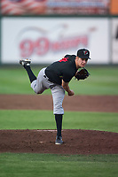 Great Falls Voyagers starting pitcher Jason Bilous (14) follows through on his delivery during a Pioneer League game against the Idaho Falls Chukars at Melaleuca Field on August 18, 2018 in Idaho Falls, Idaho. The Idaho Falls Chukars defeated the Great Falls Voyagers by a score of 6-5. (Zachary Lucy/Four Seam Images)