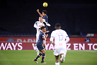24th December 2020; Paris, France; French League 1 football, Paris St Germain versus Strasbourg; MARQUINHPSG and LUDOVIC AJORQUE STRA challenge for the header