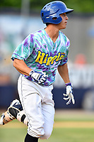 Asheville Hippies third baseman Jose Gomez (4) runs to first base during a game against the Greenville Drive at McCormick Field on June 29, 2017 in Asheville, North Carolina. The Drive defeated the Tourists 9-6. (Tony Farlow/Four Seam Images)