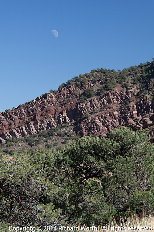 A gibbous moon rises over the walls of the canyon carved by the Arkansas River west of Canon City, Colorado.
